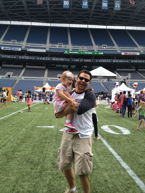 Ava and I playing on the Seahawks field
