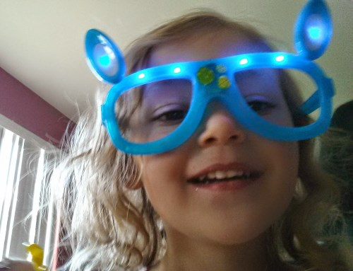 Ava taking a selfie with her new glasses on