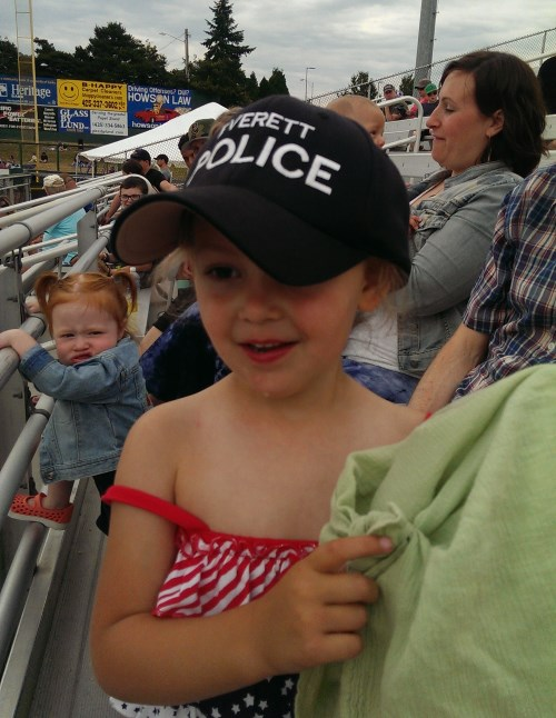 Ava wearing the police officer's hat