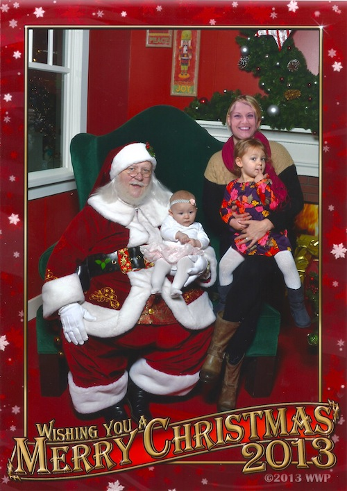 Visiting with Santa. Jessica's eyes were closed so we Photoshopped her face in from another photo. Not sure what's funnier, that or Ava's expression.