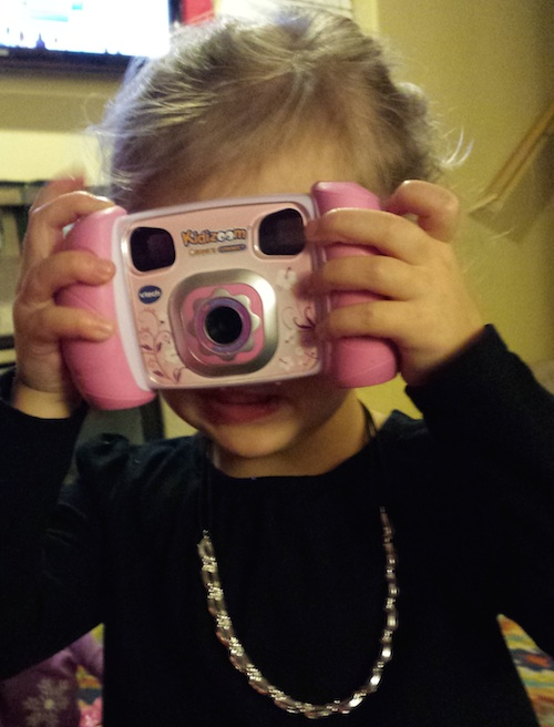 Ava loves her new camera from Uncle Joel and Aunt Melanie