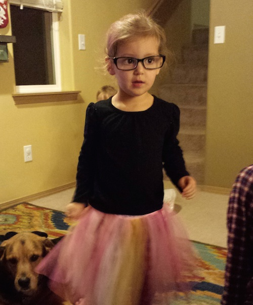 Ava wearing Nana's glasses - as usual