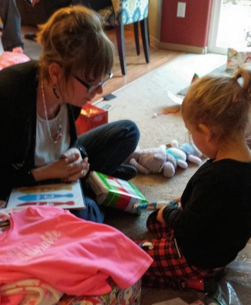 Ava and Nana opening gifts
