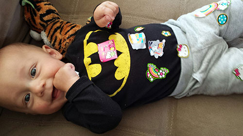 Enzo getting sticker-bombed by his sisters