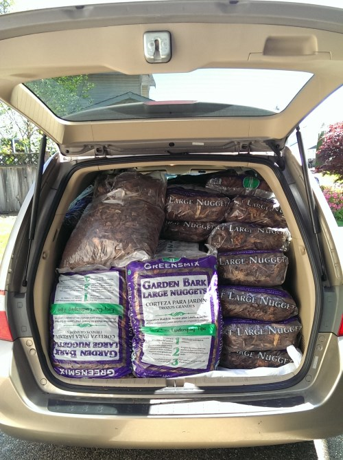 The minivan all loaded up with bark for the dog kennel