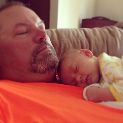 Elise napping with Grandpa