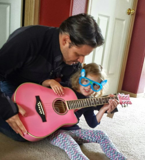 Ava checking out her new guitar