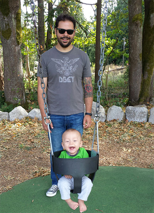 Pushing Enzo on a swing for the first time